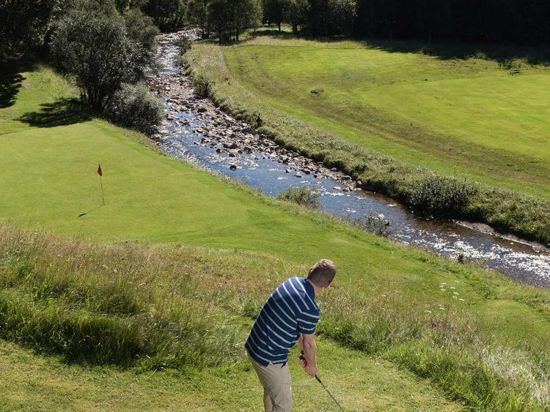 Man enjoying a late afternoon round of golf in the spectacular surrounds of Dalmunzie estate